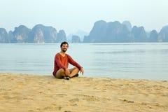 Tourist man at beach, limestone view of halong bay, vietnam Stock Photography