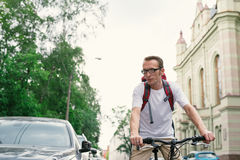 Tourist man on a bike at city street Royalty Free Stock Photos