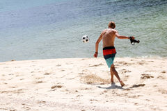 Tourist man with cameras playing football on the beach. Samui island Thailand. July 5,2017 Royalty Free Stock Photos