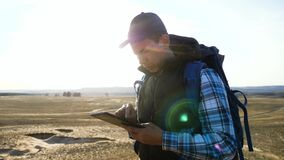 Tourist man with digital tablet a navigating looking search path on map. business concept freedom travel tourism