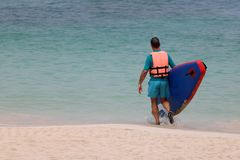 Tourist man enjoying the stand up paddle board or surfboard on t stock photos