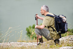 Tourist man hiking pole Stock Images