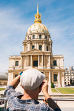 Tourist man at Les Invalides in Paris Royalty Free Stock Photography