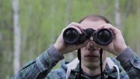 Tourist man looking through binoculars stock footage
