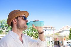Tourist man looking at the city map - summer holiday traveling royalty free stock image