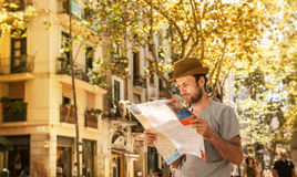 Tourist man looking at the city map - summer holiday traveling Stock Image