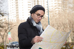 Tourist. A tourist man looking into a map Stock Images