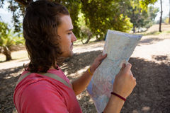 Tourist man looking at map in the park Stock Images