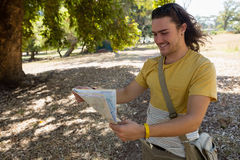 Tourist man looking at map in the park Royalty Free Stock Photo