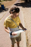 Tourist man looking at map in the park. On a sunny day Stock Photo