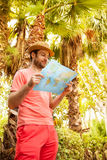 Tourist man looking at the map - summer exotic holiday Royalty Free Stock Photo