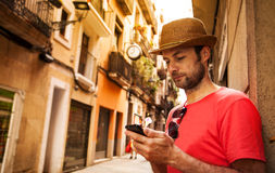Tourist man looking at mobile phone - summer holiday Stock Photos