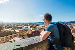 Tourist man looking to a beautiful view of the city Ljubljana. Slovenia from the top point Stock Photography