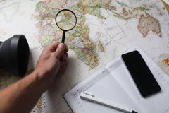 Tourist man looking at world map planning travel adventure royalty free stock photo