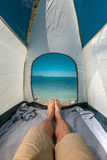 Tourist Man Lying In Tent With A View Of  Sea Summer Beach Holiday Vacation Concept. View Of Legs. Point Of View Shot Stock Image