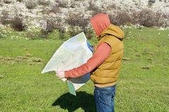 Tourist man  in mountain read the map. Stock Photo