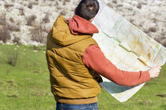 Tourist man  in mountain read the map. Royalty Free Stock Image