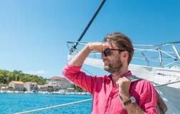 Tourist man or sailor standing by yacht - sea marina Stock Photos