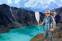 Tourist man on scenery mountain landscape background Royalty Free Stock Images