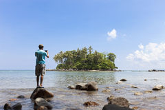 Tourist man standing on the stone in summer season and take a ph Royalty Free Stock Photos