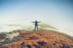 Tourist man stands in freedom pose Royalty Free Stock Image