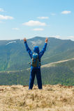 Tourist, man and success in mountains, arms raised Stock Photo