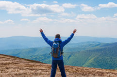 Tourist, man and success in mountains, arms raised Stock Photography