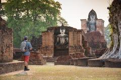 Tourist man take a photos at Sukhothai historical park, Mahathat Temple. Sukhothai ,Thailand Stock Photo