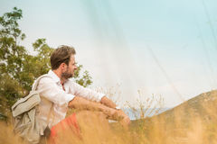 Tourist man taking a break while mountain trip Royalty Free Stock Images