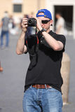 Tourist man taking a photo with digital camera Royalty Free Stock Images