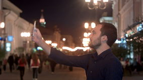 Tourist man taking photo in with smartphone at stock video