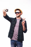 Tourist man taking selfie from phone on white background. Happy tourist man taking selfie from phone on white background stock images