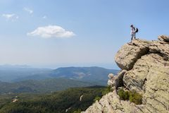 Tourist man on top of high mountains of peninsula Sithonia Royalty Free Stock Image