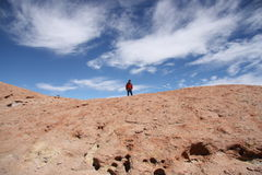 Tourist man on the top of Volcano, Uyuni, Bolivia Stock Photography