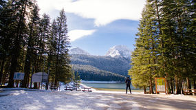 Tourist man travel to snowy mountains Stock Photography