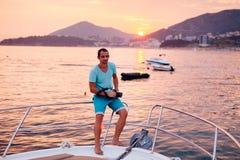 Tourist man travel on yacht at sunset Royalty Free Stock Image