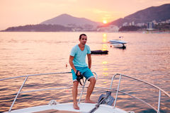 Tourist man travel on yacht at sunset Royalty Free Stock Images