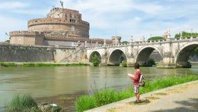 Tourist man traveling around rome, italy stock video
