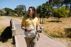 Tourist man walking with map in the park. On a sunny day Stock Photos