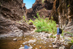 Tourist man walking on the trail in the canyon Masca Stock Photo