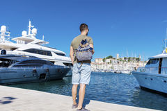 Tourist man watching the  harbor in Cannes. Azure coast Royalty Free Stock Photo
