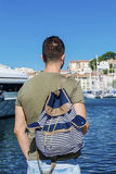 Tourist man watching the  harbor in Cannes. Azure coast Stock Image