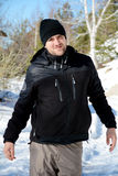 Tourist  man   in the winter forest ,enjoying the winter snow Royalty Free Stock Photos