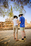 Tourist man and woman looking the map at Ayutthaya Historical Pa stock images