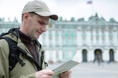 Tourist with a map Stock Photography