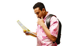 Tourist with map. Tourist reading map with expressive curious face Royalty Free Stock Photography