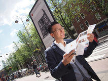 Tourist with a map. In Amsterdam stock photo