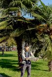 Tourist with a map on the background of palms. In Italy Stock Image