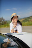 Tourist with a map at the car checks the route to the destinat Stock Photo