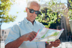 Tourist with a map in city stock photos